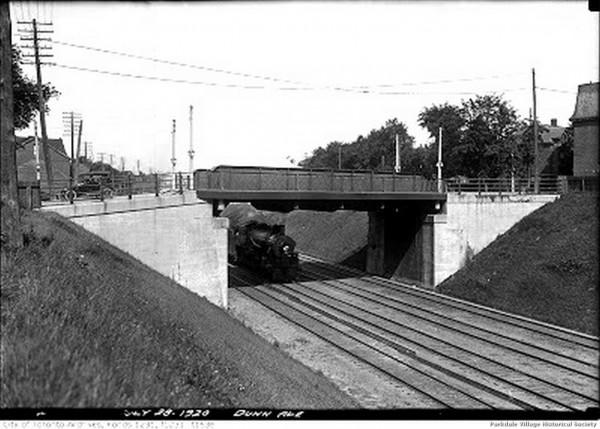1920 July 28, - looking west along the Grand Trunk rail the Dunn Ave. bridge. Dunn Milk at the far right_tn